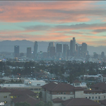 Sunrise over downtown Los Angeles this morning as viewed from a web cam on the USC campus. #LAweather http://t.co/HAYyq59u0s