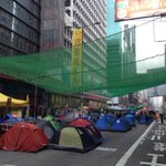 A whole bunch of sleepy-eyed people are wondering when Mongkok got this new catch-net. #UmbrellaRevolution #OccupyHK http://t.co/pE7MREs7vA