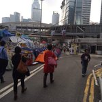 Commuters coming off the subway at Admiralty station #occupyCentral #justanotherdayoftheorotests http://t.co/WVKYB8m56Q