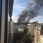 Photo: Smoke billows from top floors of Radio France headquarters in Paris - @SylvainTronchet https://t.co/fhOCo7jnwd