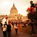 Folks filing in to Civic Center in the rain for todays #SFGparade. Everyones decked out in @SFGiants gear. http://t.co/waWNTA5LAo