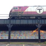 500 portraits now hanging up beneath Commuter Rail tracks via @RawArtWorks. http://t.co/DNnhANFFzs #mbta http://t.co/5axdHmdxRh
