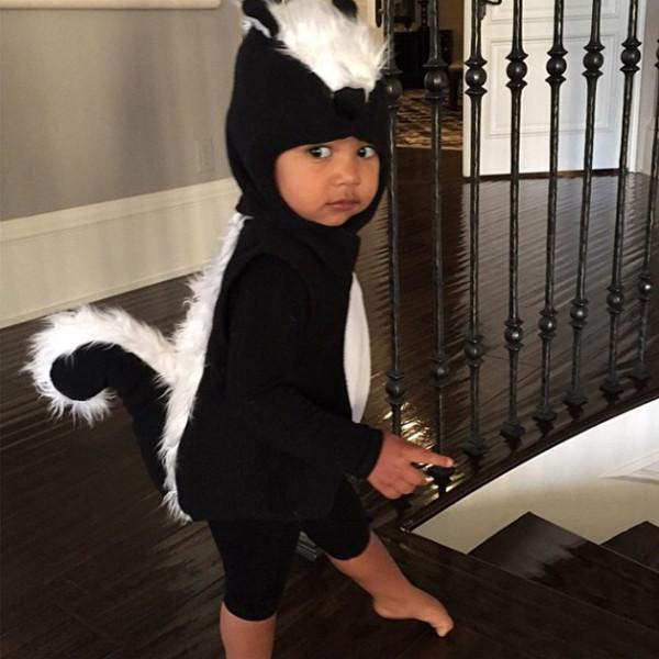 North West is SO adorable in her little skunk costume: