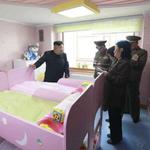 World's bravest troll brilliantly photobombed a Kim Jong-un publicity photo. http://t.co/9DW9SlaYJV http://t.co/1LJgp8i7Bv