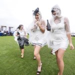 Rain poncho the must have accessory for #DerbyDay. PHOTO by Luis Ascui #Flemington #SpringRacing @theage #melbourne http://t.co/vlSwESedg2