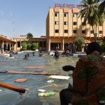#UPDATE Kids swim at a ransacked hotel, as Burkina Faso president flees and army takes over http://t.co/5yjmZOCUrr http://t.co/EQrr8bXrEm