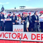 Damien Oliver receives his 5th @AAMI Victoria Derby trophy for his win on Preferment. #DerbyDay http://t.co/DweiC0A0VA