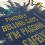 """#Melbourne sidewalks where trams empty out, remind cyclists about """"friendly belling."""" Are you a friendly beller? http://t.co/JZ4Av4devK"""