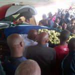 #FinalFarewell Senzos coffin is placed in the hearse. It will head to his brothers grave for a ritual before MMS http://t.co/YD5qLhzLym