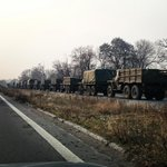 Huge military convoy is waiting on the eastern entrance to #Donetsk.  Armed Kamaz trucks w munitions, Grads, a/a guns http://t.co/STZbxwjksn