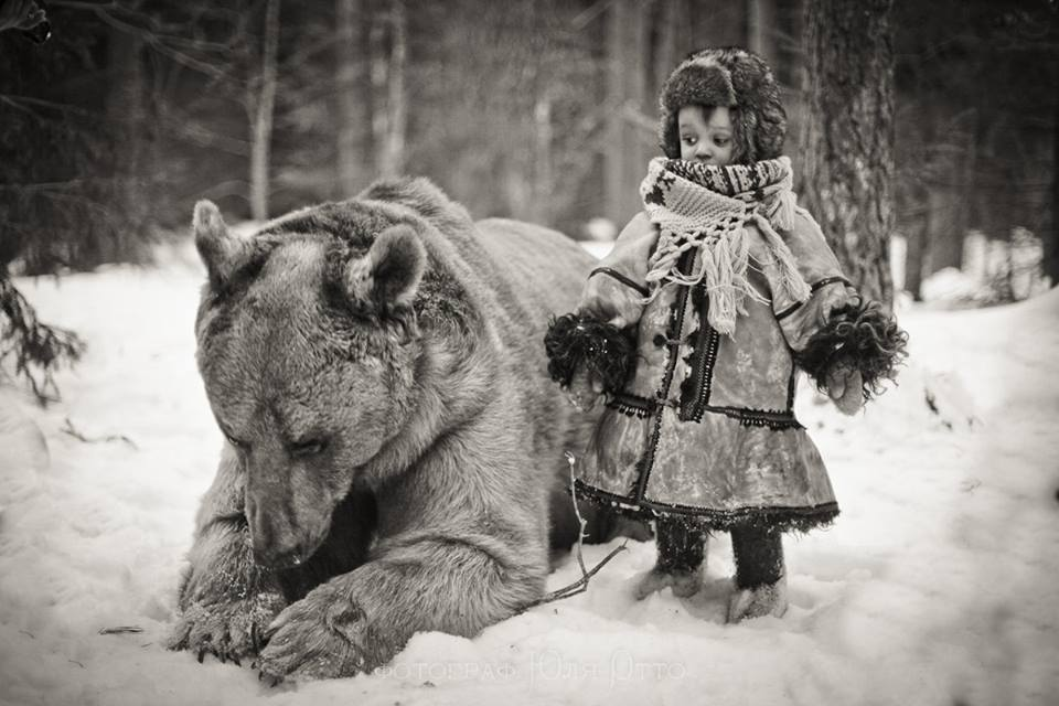 A child with a wild bear in Russia: http://t.co/CTo99UU6gd