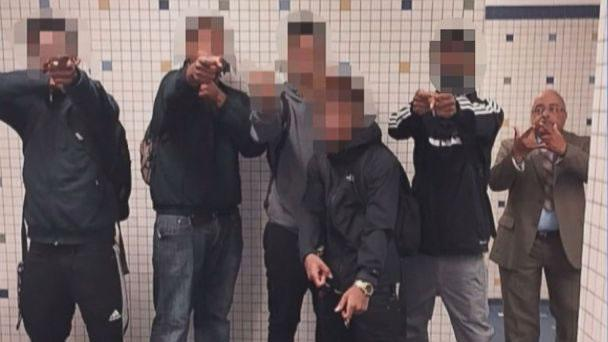 A high school denies that its principal is flashing gang signs in a recent pic with students. http://t.co/nTJrnPb9ya http://t.co/5wDlDQB8T8