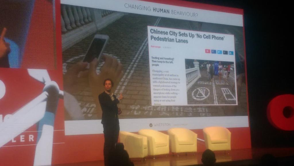 Whoa. In Chonqing, China, a separate pedestrian lane for non cell-phone users to avoid digital zombies. #OMDPredicts http://t.co/b4DEBCUH1y