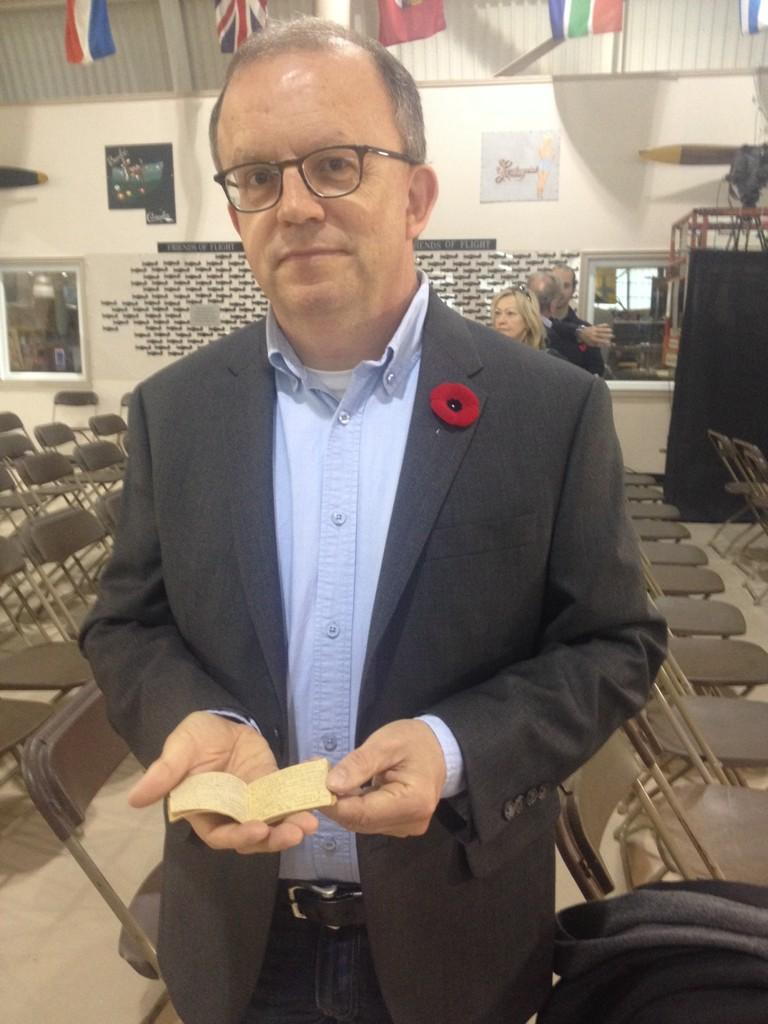 Archivist Rick Stapleton holds WW2 recipe book,size of palm. Written in concentration camp! @CWHM @morninglive http://t.co/mT5q8fJw38