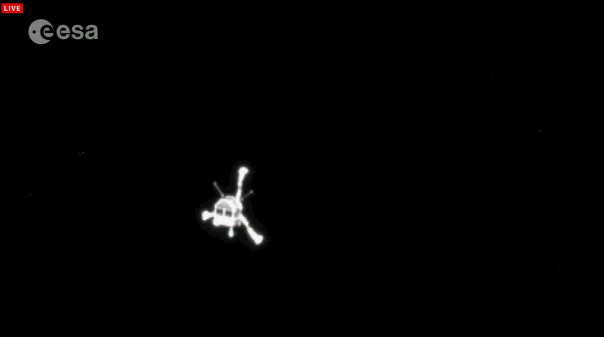 "Look at that! ""@NASASpaceflight: Epic view of Philae on the way to the comet! http://t.co/GPLzU25Q1A"" #CometLanding"