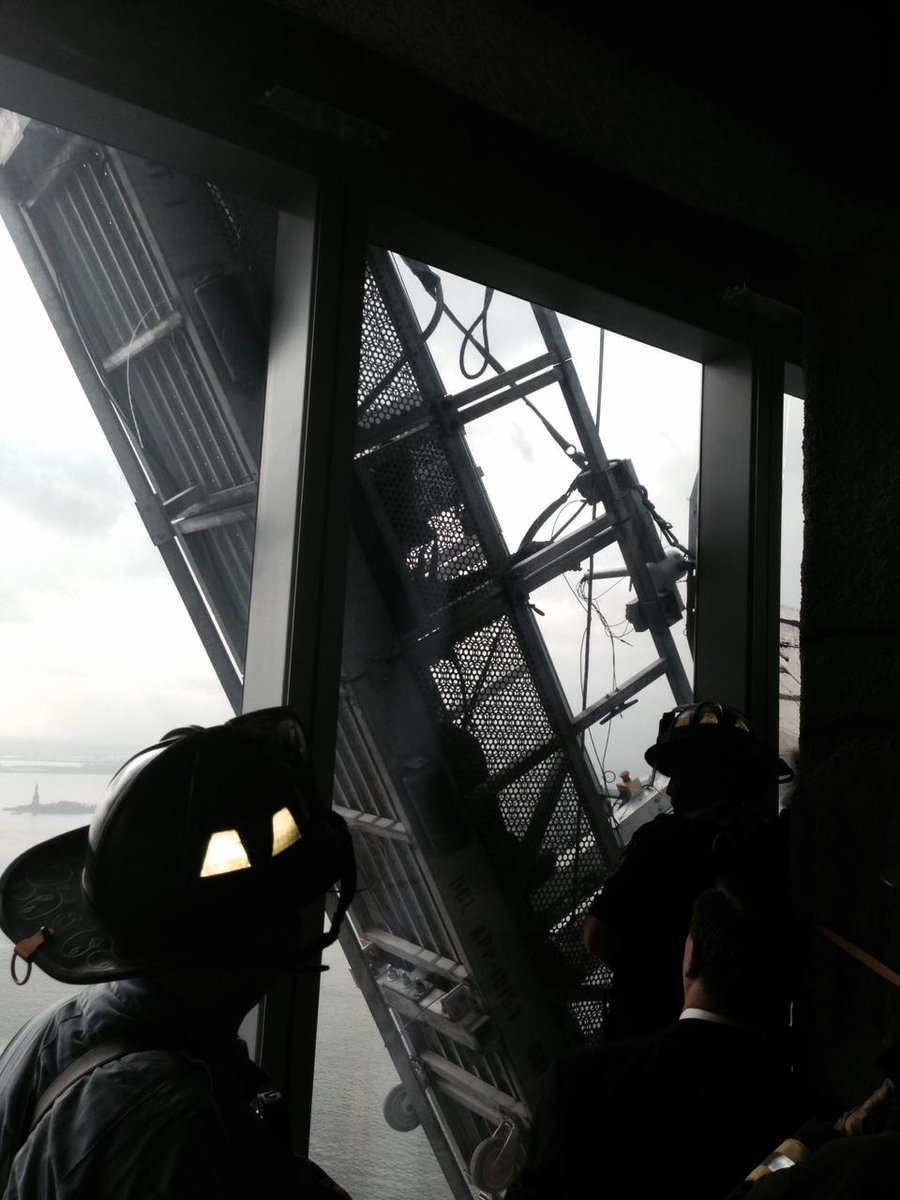 Now: #FDNY rescuing workers trapped on scaffolding outside 1 World Trade Center. View from the 68th floor. http://t.co/3c7Oi8EZPD