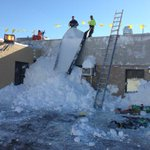 Workers clear snow off roof of Garden Gate Health Care Facility in West Seneca http://t.co/ZJkhogkyu1