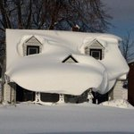 This house appears to enjoy the snow. Look at that smile!  [ PHOTO / @confusedcaboose in the Buffalo, NY area ] http://t.co/VfIuI1W0wz