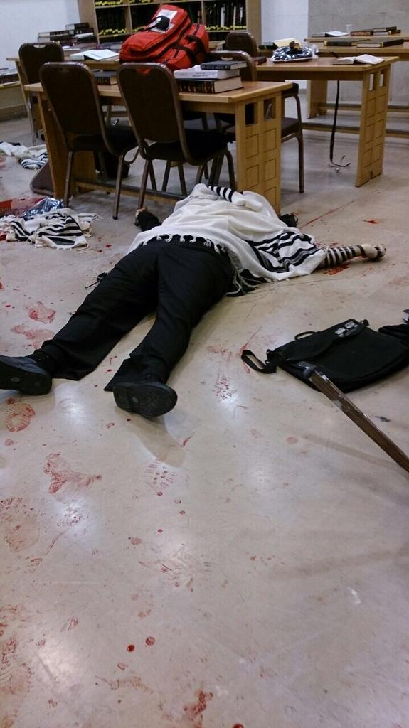 WARNING: Graphic images. Slain in the middle of prayer.  Who wants peace with those who can do this? #Israel #Gaza http://t.co/6f74bZbuMD