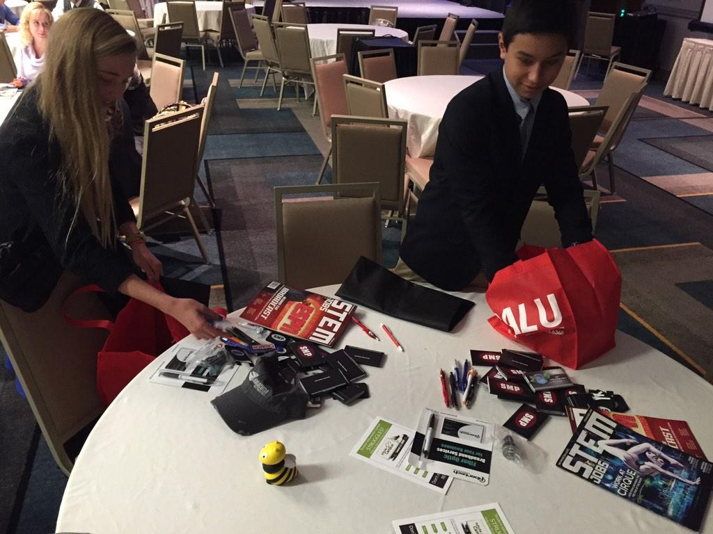 .#TRETC2014 Vendor trick-or-treat. @willkabazie and Annika empty their tote bags. #score http://t.co/PLAgakql4Y