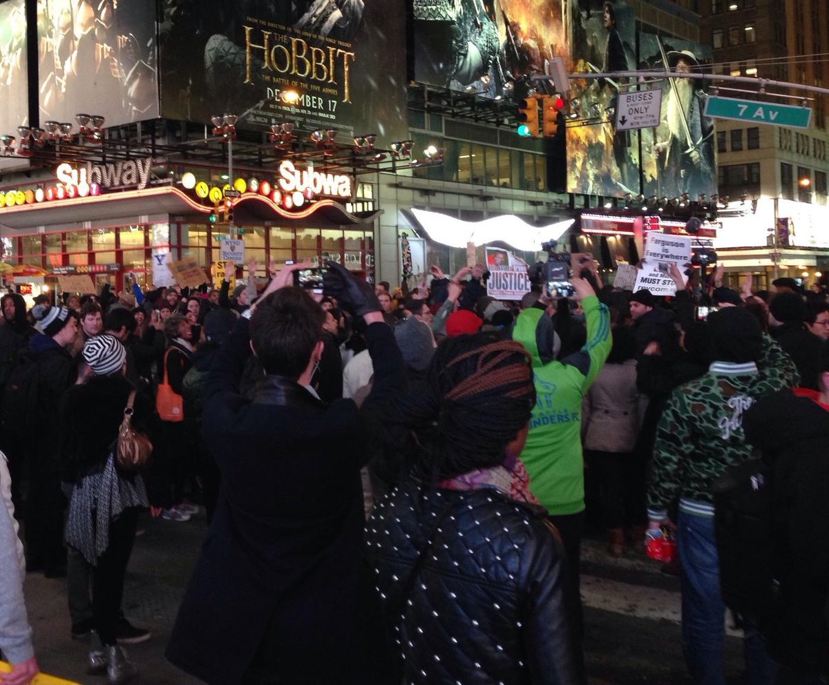 "Protesters in Times Square chanting ""I can't breathe."" http://t.co/iDav9xivJC"