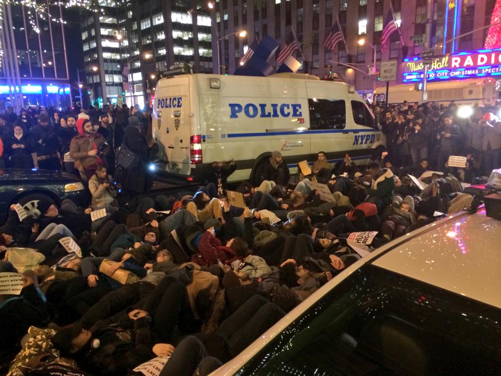 """#NYC """"@ashdollarsign: Police are putting on their riot gear as everyone lies down in the street. #EricGarner http://t.co/1oft2IF51F"""""""