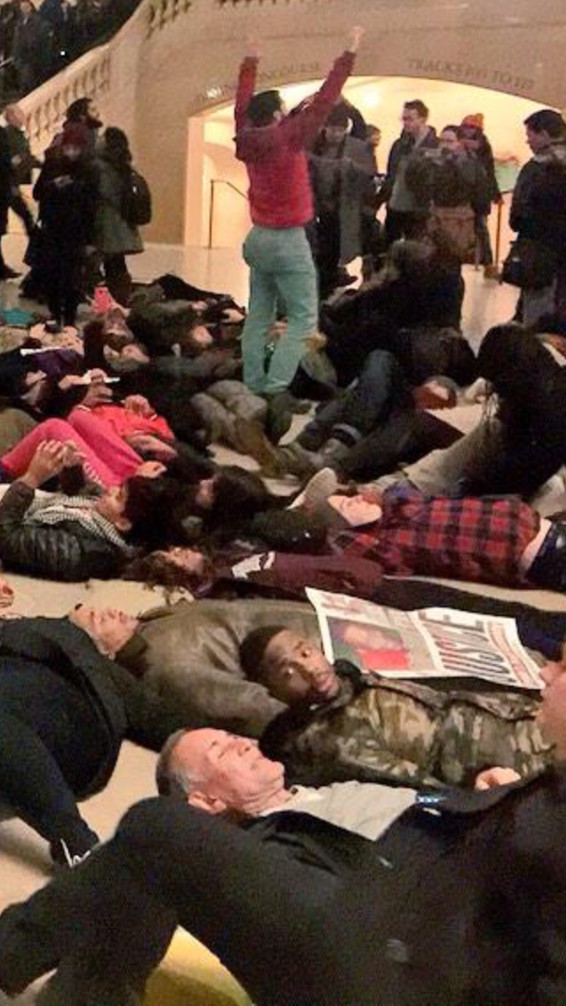 This kid in the Grand Central die-in has a very valid reaction to this old white dude. (src http://t.co/da6rCIv8OF) http://t.co/xwsEqOjSVP