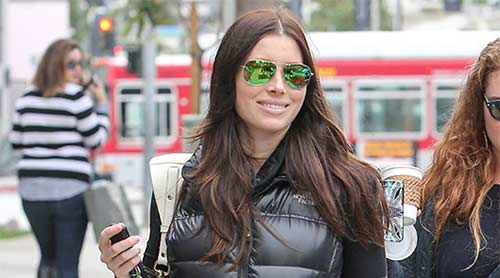 Jessica Biel keeps her 'baby bump' under wraps as she heads out with friends