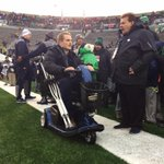 #NotreDame LB @joeschmidtiv in good spirits and sporting a sweet stache on his scooter. http://t.co/D48BVBgqly