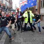 Watch the moment rugby fans (and a policeman) bring a city street to a halt with fearsome haka http://t.co/3nYLIqk6ff http://t.co/RzIiOvmN3W