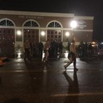 Aaand suddenly dozens of cops are out of the PD in Ferguson http://t.co/Wz2nCwhtZd