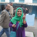 A Tunisian woman shows her ink-stained finger after voting in the presidential elections. #TnPrez #TnElec2014 #Tnelec http://t.co/YiwSBMi4Dg