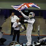 Lewis #Hamilton #F1 Champion waves the flag of a nation he rejected to avoid paying tax there http://t.co/lngDdSvQwN http://t.co/wzf4aUURMi