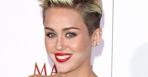 Happy 22nd birthday to Miley Cyrus! See some of her wildest concert pics! (NSFW...)