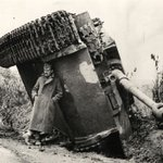 A British soldier hiding from the rain under an overturned Tiger tank, Italy, 1944. http://t.co/0dcrXeMS1z