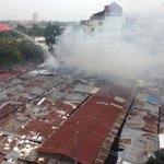 Fire has destroyed part of the Old Market in Phnom Penh this morning #Cambodia http://t.co/0iV4DGC9Ii