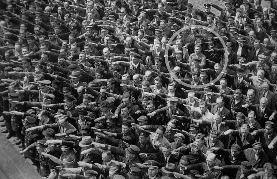 His name is August Landmesser he was a ship worker and refused to do a Nazi salute because his wife was Jewish: http://t.co/mG86VrUoOk