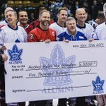#Leafs Alumni present Gary Scullion with a cheque for 5k at the recent Hockey Helps the Homeless event. #TMLtalk http://t.co/uzLLx2sRxM