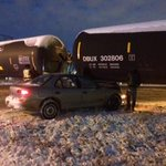 DELAYS: Car hit train @ 51 Avenue, 86 Street. Minor, no serious injuries. #yegtraffic http://t.co/I6SZfV6iiV