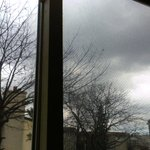 Mississauga and all S.Ontario is in for a major wind storm with rain, its really dark out there now #OnStorm http://t.co/WjSAx8B8AM