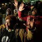 PHOTO: Protesters in Ferguson, Mo., raised their hands ahead of the grand jury decision http://t.co/euoHu74AYG http://t.co/wQ1GipU05w
