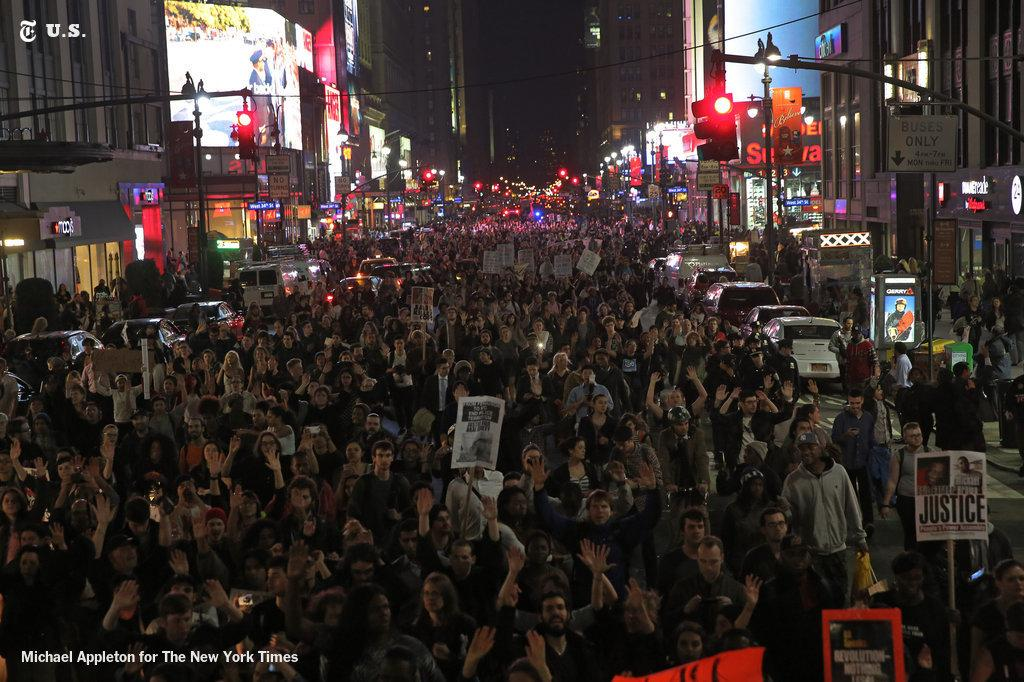 Protesters march up Seventh Avenue in New York City, following the grand jury decision in Ferguson. @NYTNational http://t.co/ZxlX0W0A7v