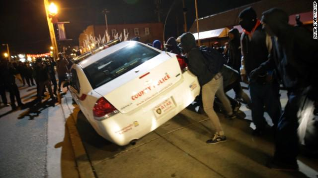 Police fire tear gas at protesters trying to overturn a patrol car. #FergusonDecision http://t.co/n4rHuvhASS http://t.co/GBTDZ1Qosi