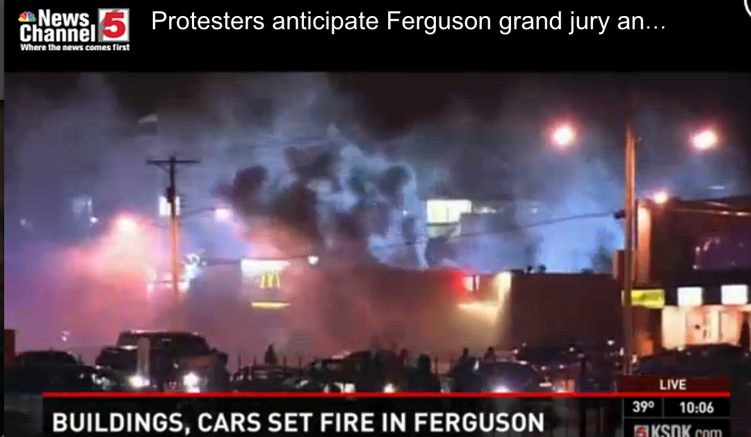 Businesses are being set on fire #Ferguson http://t.co/TPCSw9fsws