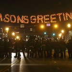 .@Reuters Photo: Police form a line in the street under a holiday sign in Ferguson, Missouri http://t.co/Qws7t6KG7D