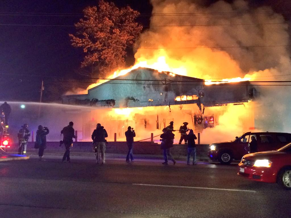 This Little Caesars is fully engulfed in flames. #Ferguson @kmoxnews http://t.co/L0ImAv77WY