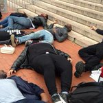 """PROTESTS IN #DC: One group lay on the ground to stage a """"die-in in front of @DCPoliceDept. http://t.co/mRaGojRTXS http://t.co/ECfVL5qnBI"""