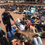 "Students at UNC holding a ""die in"" for four and a half minutes to represent #MichaelBrown after he was shot http://t.co/dqSmkQjdiT"