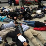 Peaceful counterpart to #Ferguson protests: #DC die-ins. 4 mins to signify 4 hrs #MichaelBrowns body in st. @wusa9 http://t.co/njNf2a5Vpo