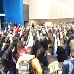 "Students have arrived in front of the CNN Center. Chanting now ""no justice, no peace."" http://t.co/tLyiNCmGi6"